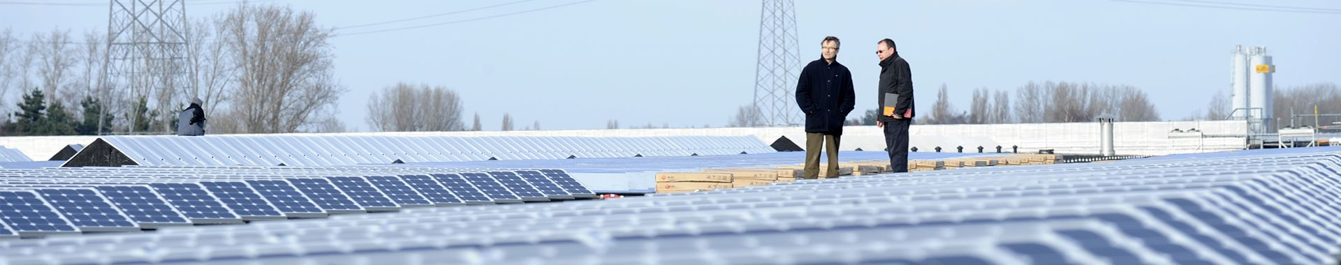 Managers on business roof with solar panels
